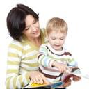 Teacher and boy reading